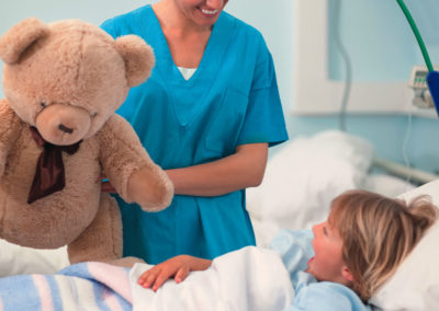 Nurse holding a teddy bear